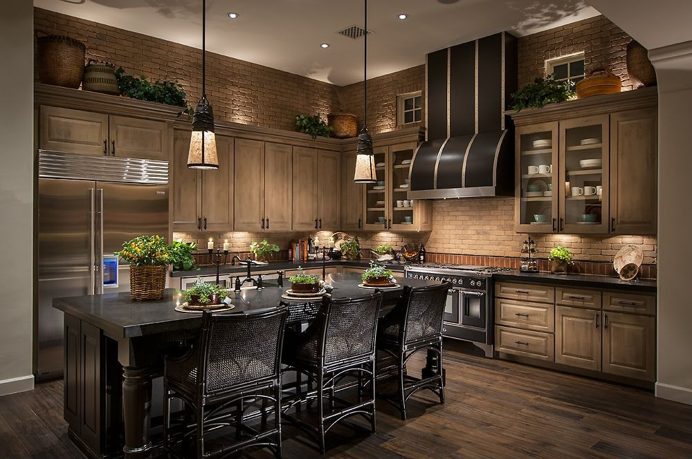 dark toned wood cabinetry and light marble surfaces, with large island