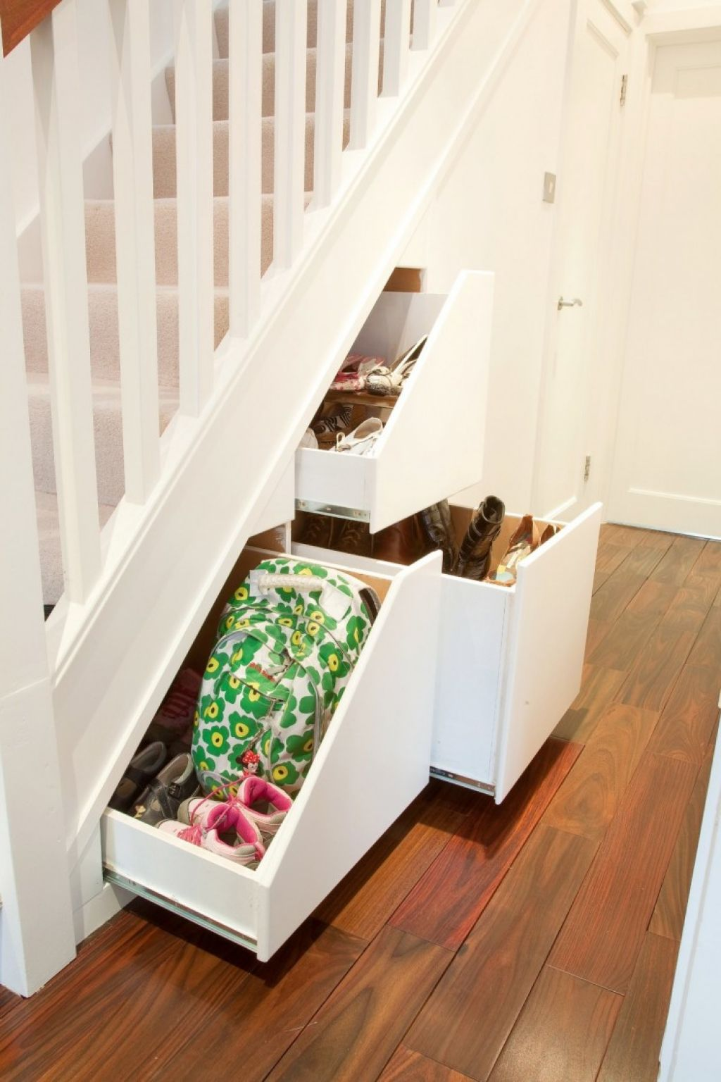 Creative ideas for maximizing space under the stairs for Living room designs under the stairs