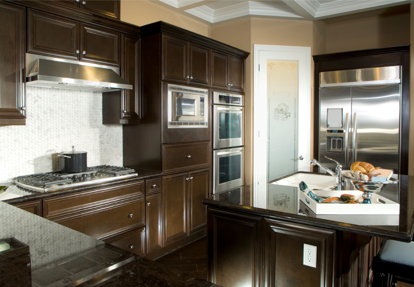 Luxurious, open kitchen with stained wood cabinetry and large, two