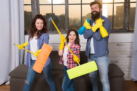 Expert house cleaning service you can trust. Family cleaning house. Happy family hold cleaning products. Mother, father and daughter cleaning house. Clean house. Everything should be perfect.