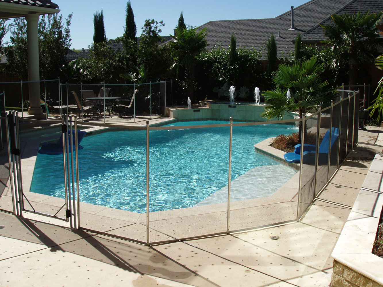 Architecture awesome cement deck with glass fence in for Pool deck decor ideas