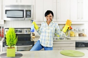 Girl-Cleaning-Kitchen-Happily