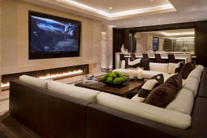 Luxury-Home-Cinema-design-fireplace-Screen-Flat-TV-sofa-cushion-table