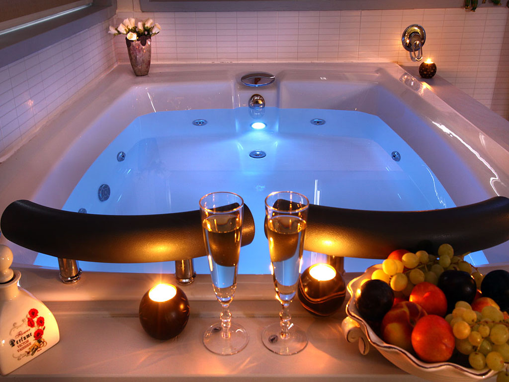 Beautiful bathroom with elegant candles for Best spa for couples