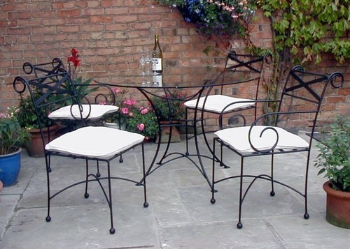 Make the best out of wrought iron furniture for interiors for Wrought iron furniture